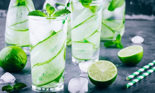 Ice cold and refreshing detox water cucumber and mint in a glass jar